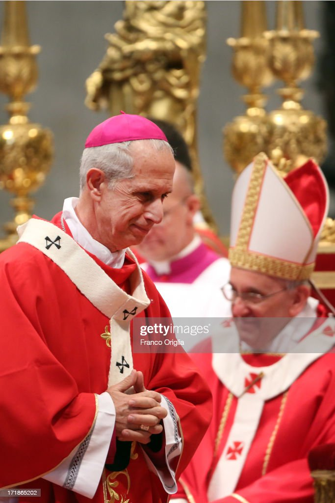 New Archbishop of Buenos Aires Mario Aurelio Poli receives the Pallium as a new metropolitan archbishop from <a gi-track='captionPersonalityLinkClicked' href=/galleries/search?phrase=Pope+Francis&family=editorial&specificpeople=2499404 ng-click='$event.stopPropagation()'>Pope Francis</a>, whom he replaced after his elections as Pontiff, during the Solemnity of Saint Peter and Paul at Vatican Basilica on June 29, 2013 in Vatican City, Vatican. <a gi-track='captionPersonalityLinkClicked' href=/galleries/search?phrase=Pope+Francis&family=editorial&specificpeople=2499404 ng-click='$event.stopPropagation()'>Pope Francis</a> delivered the homily at Mass in St Peter's Basilica on Saturday morning, to mark the Solemnity of Saints Peter and Paul, Apostles and Patrons fo the city of Rome. In his remarks following the Gospel reading, the Holy Father focused on a particular task of the Petrine ministry, which is to strengthen, or confirm, all the faithful.