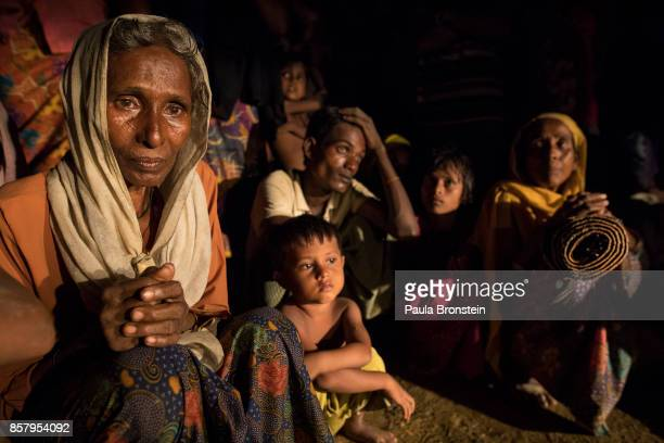 New arrivals rest after a long truck ride from the border without any knowledge of where to go next on October 5 2017 in Kutupalong Cox's Bazar...