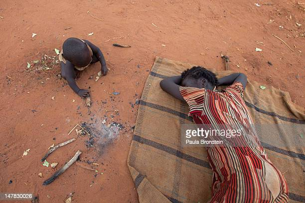 New arrivals sleep on the ground as they crowd together living in makeshift shelter at the Yida refugee camp along the border with North Sudan July 4...
