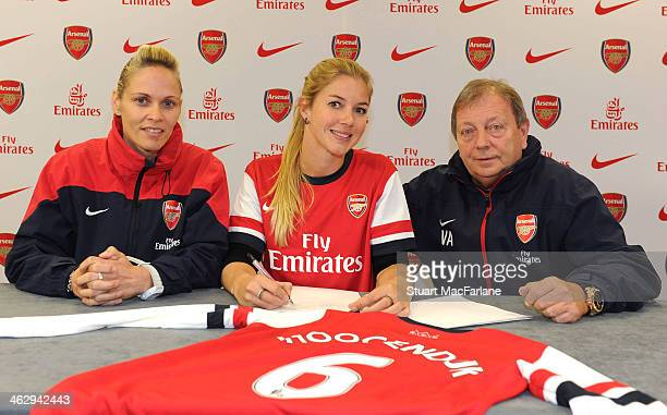 New Arsenal Ladies signing Anouk Hoogendijk poses with Manager Shelley Kerr and General manager Vic Akers at London Colney on January 15 2014 in St...