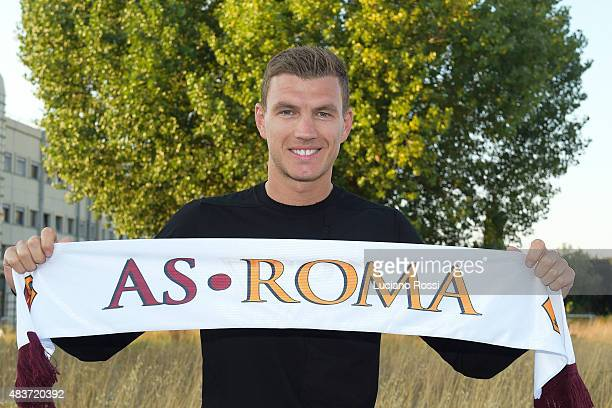 New AS Roma signing Edin Dzeko arrives at Rome airport greeted by huge crowd August 12 2015 in Rome Italy