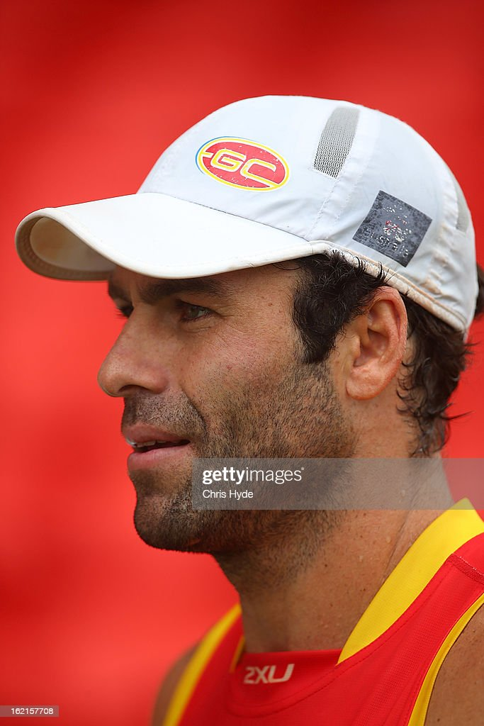 New assistant coach <a gi-track='captionPersonalityLinkClicked' href=/galleries/search?phrase=Dean+Solomon&family=editorial&specificpeople=206873 ng-click='$event.stopPropagation()'>Dean Solomon</a> talks to media after a Gold Coast Suns AFL training session at Metricon Stadium on February 20, 2013 in Gold Coast, Australia.