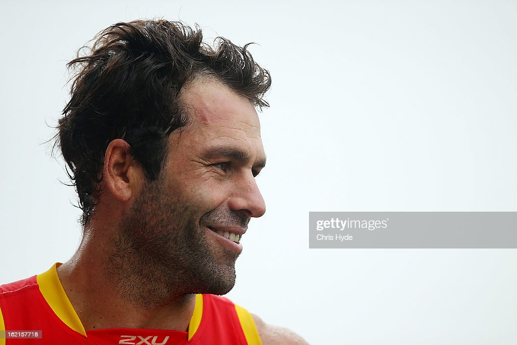 New assistant coach Dean Solomon talks to media after a Gold Coast Suns AFL training session at Metricon Stadium on February 20, 2013 in Gold Coast, Australia.