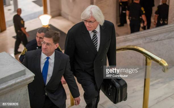 New attorneys representing Cosby in his retrial Sam Silver and Tom Mesereau climb the stairs to Courtroom A at the Montgomery County Courthouse on...
