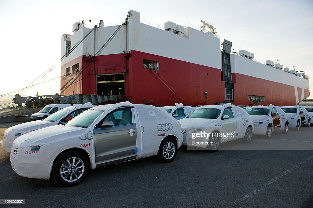New Audi AG automobiles stand beneath protective covers on the dockside beside the Le Mans Express roll on, roll off (RoRo) ship at Barcelona port in Barcelona, Spain, on Thursday, Jan. 10, 2013. Spanish exports grew the least in five months in September as the euro area relapsed into a recession and the region's fourth-largest economy continued to contract. Photographer: David Ramos/Bloomberg via Getty Images