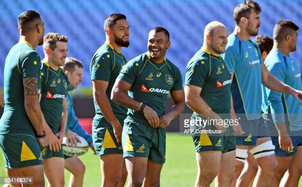 New Australian Wallabies rugby player Curtis Rona and teammate Kurtley Beale participate in the Captain's Run in Sydney on August 18 2017 The...