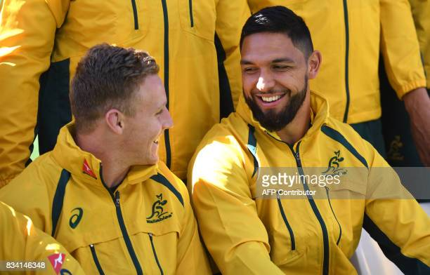 New Australian Wallabies rugby player Curtis Rona chats with teammate Reece Hodge during the Captain's Run in Sydney on August 18 2017 The Wallabies...