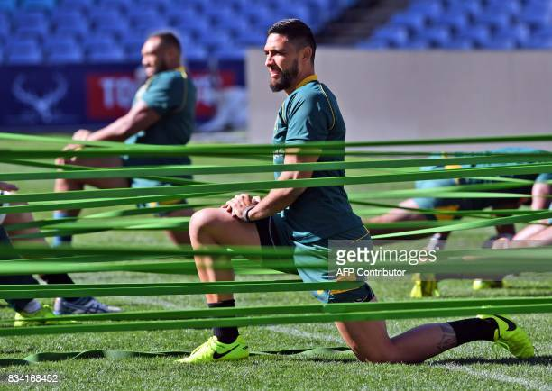 New Australian Wallabies rugby player Curtis Rona goes though his stretching exercises during the Captain's Run in Sydney on August 18 2017 The...