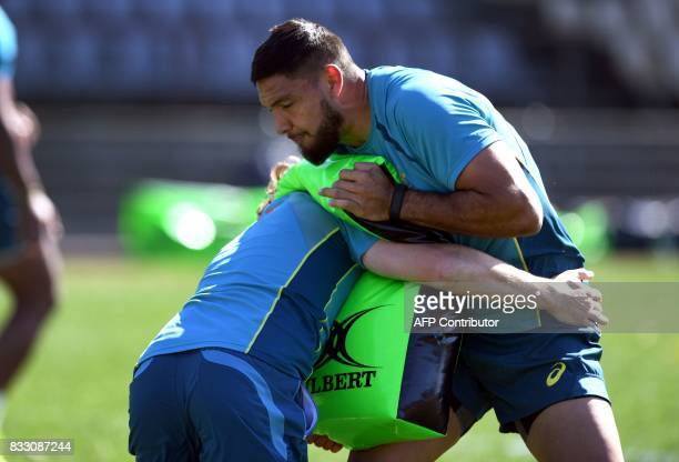 New Australian Wallabies rugby player Curtis Rona is tackled during a training session in Sydney on August 17 2017 ahead of the first Rugby...