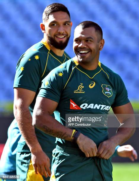 New Australian Wallabies rugby player Curtis Rona shares a lighter moment with teammate Kurtley Beale during the Captain's Run in Sydney on August 18...