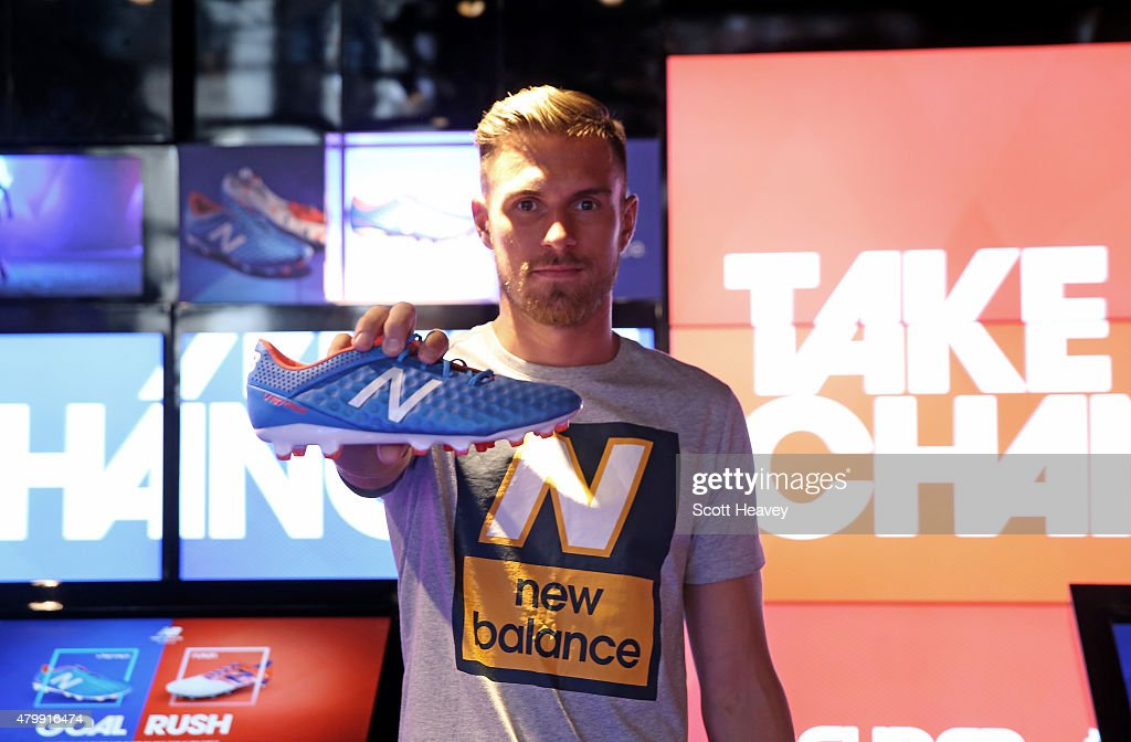 New Balance player, Arsenal's <a gi-track='captionPersonalityLinkClicked' href=/galleries/search?phrase=Aaron+Ramsey&family=editorial&specificpeople=4784114 ng-click='$event.stopPropagation()'>Aaron Ramsey</a> attends the launch of the New Balance Visaro and Furon boot at Pro Direct LDN19 on Carnaby Street on July 8, 2015 in London, England.