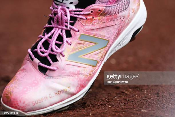 New Balance specialty Susan G Komen shoes are used during a game between the Milwaukee Brewers and the New York Mets on May 13 2017 at Miller Park in...