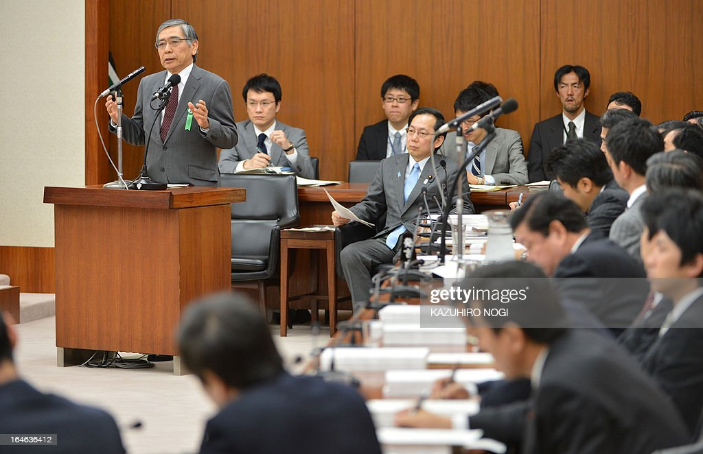 New Bank of Japan governor Haruhiko Kuroda (L) answers questions during a session of the lower house finance committee at the parliament in Tokyo on March 26, 2013. Kuroda has been appointed to head the bank for only three weeks through April 8, when the term of his predecessor will formally end.