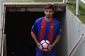 New Barcelona's Portuguesse forward Andre Gomes arrives on field for his official presentation at the Camp Nou stadium in Barcelona on July 27 after...