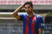 New Barcelona's Portuguesse forward Andre Gomes gestures as he poses during his official presentation at the Camp Nou stadium in Barcelona on July 27...
