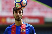 New Barcelona's Portuguesse forward Andre Gomes looks at a ball during his official presentation at the Camp Nou stadium in Barcelona on July 27...