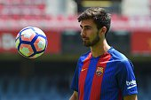 New Barcelona's Portuguesse forward Andre Gomes watches a ball during his official presentation at the Camp Nou stadium in Barcelona on July 27 after...