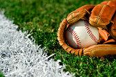 New Baseball in glove along foul line