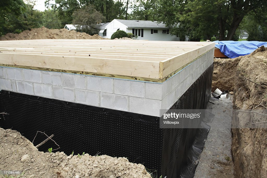 New basement foundation waterproofing stock photo getty for New construction basement