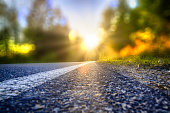 Street in backlight with bokeh, lensflares and sunbeams