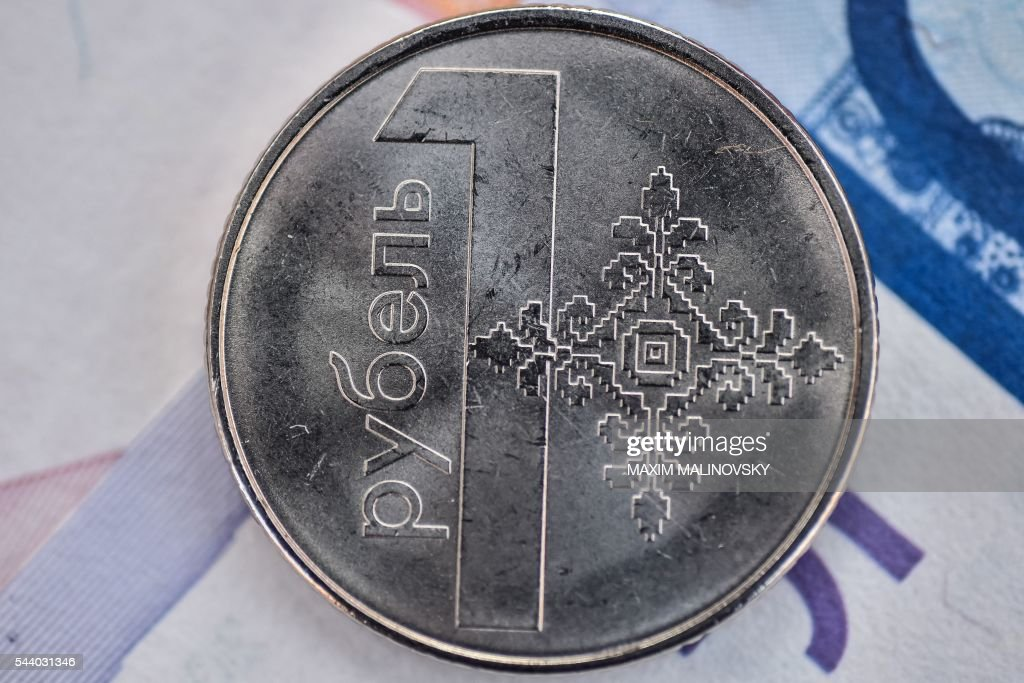 A new Belarus ruble coin is pictured in Minsk on July 1, 2016. Belarus is slashing four zeros from banknotes, the central bank said on June 30, in a move authorities hope will curb inflation. New banknotes, ranging from 5 to 500 Belarusian ruble notes, are put in circulation on July 1, the bank said. The Belarussian ruble - which currently stands at close to 20,200 to the US dollar (22,450 to the euro) - has suffered heavily from inflation in recent years together with the nation's centralised economy. MALINOVSKY