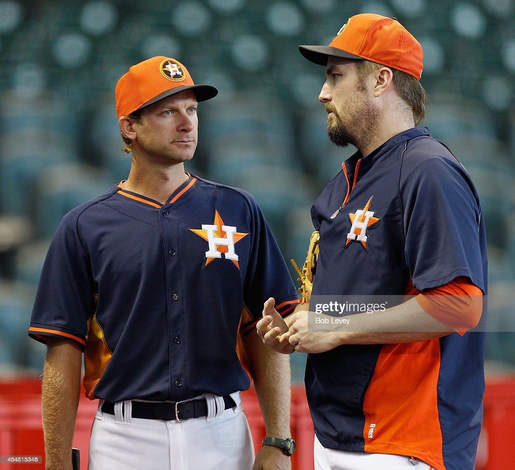New bench coach <a gi-track='captionPersonalityLinkClicked' href=/galleries/search?phrase=Adam+Everett&family=editorial&specificpeople=194904 ng-click='$event.stopPropagation()'>Adam Everett</a> #36 of the Houston Astros talks with pitcher <a gi-track='captionPersonalityLinkClicked' href=/galleries/search?phrase=Chad+Qualls&family=editorial&specificpeople=588432 ng-click='$event.stopPropagation()'>Chad Qualls</a> #50 before playing the Los Angeles Angels of Anaheim at Minute Maid Park on September 2, 2014 in Houston, Texas.