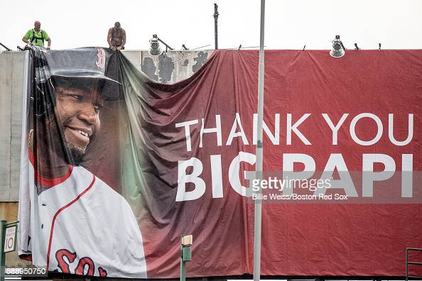 A new billboard for David Ortiz of the Boston Red Sox is installed on Lansdowne Street above Fenway Park before a game between the Boston Red Sox and...