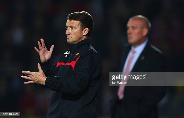 New Billy McKinlay manager of Watford gives instructions as Mark Warburton manager of Brentford looks on during the Sky Bet Championship match...