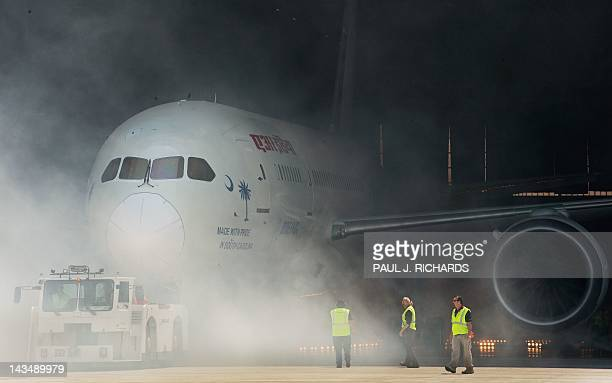 A new Boeing 787 Dreamliner built for Air India is rolled out of the hangar with a smoke machine and fireworks presentation April 27 at Boeing's new...