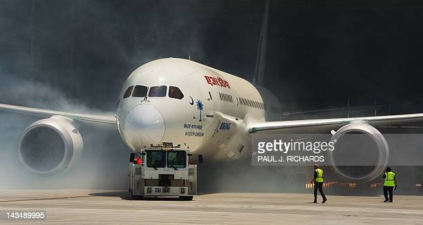A new Boeing 787 Dreamliner built for Air India is rolled out of the hangar with a smoke machine and fireworks presentation April 27at Boeing's new...