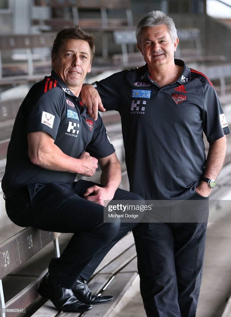 New Bombers coach Mark Thompson (L) flexes his muscles with new Senior Assistant coach <a gi-track='captionPersonalityLinkClicked' href=/galleries/search?phrase=Neil+Craig&family=editorial&specificpeople=217300 ng-click='$event.stopPropagation()'>Neil Craig</a> during an Essendon Bombers AFL press conference at Windy Hill on October 10, 2013 in Melbourne, Australia.