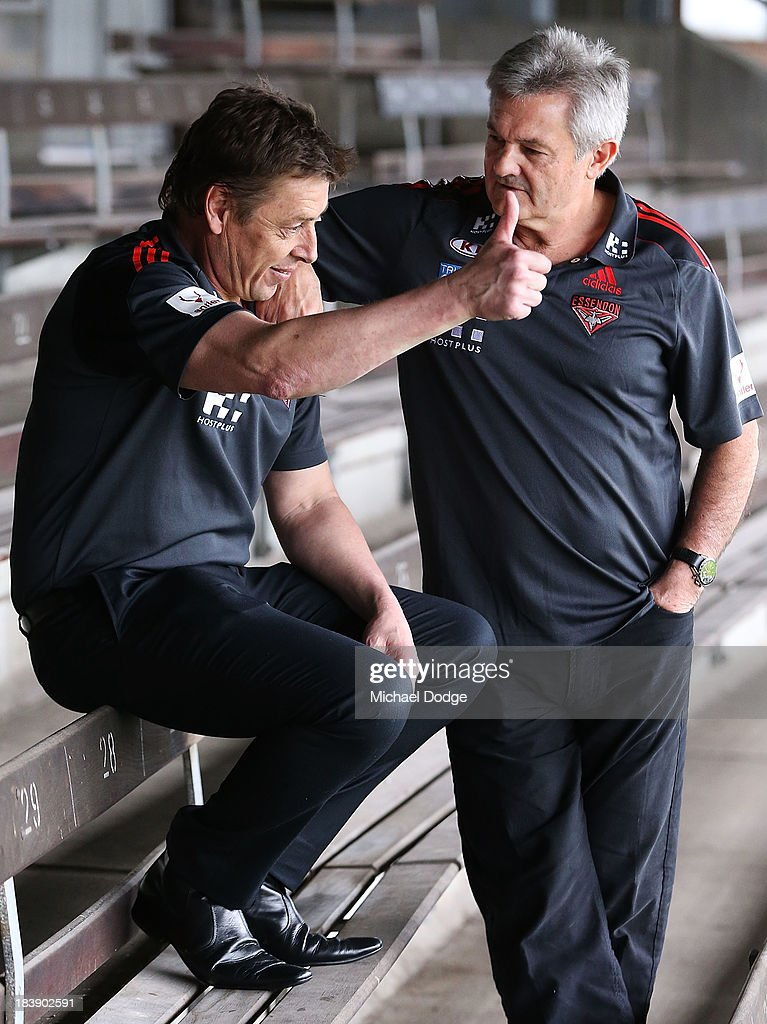 New Bombers coach Mark Thompson (L) gestures next to new Senior Assistant coach <a gi-track='captionPersonalityLinkClicked' href=/galleries/search?phrase=Neil+Craig&family=editorial&specificpeople=217300 ng-click='$event.stopPropagation()'>Neil Craig</a> during an Essendon Bombers AFL press conference at Windy Hill on October 10, 2013 in Melbourne, Australia.
