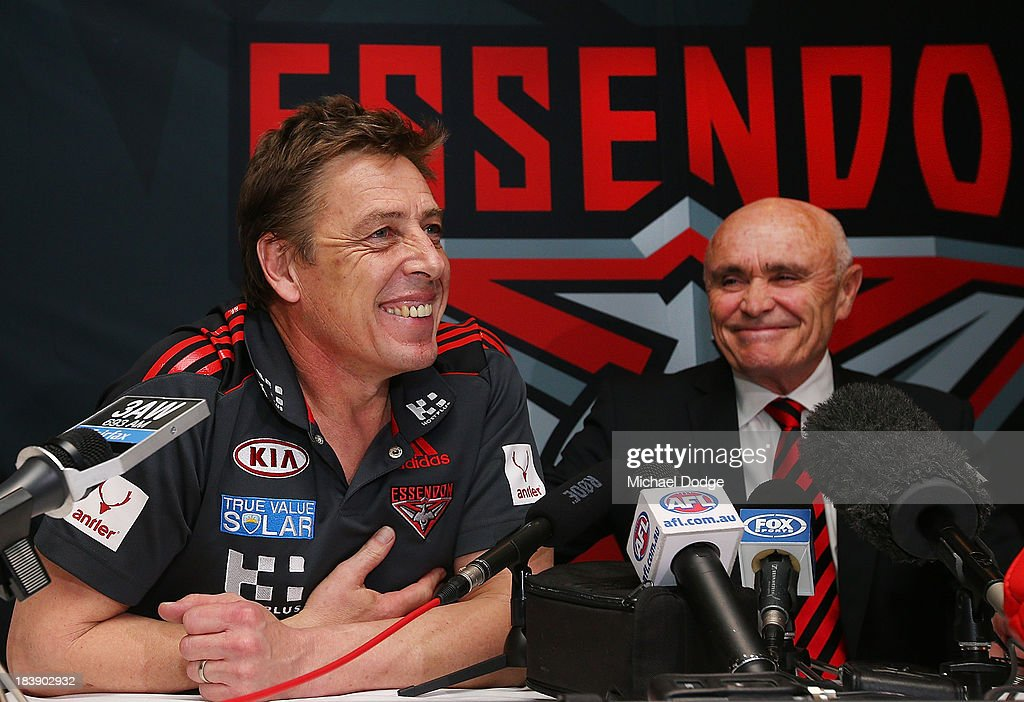 New Bombers coach Mark Thompson reacts next to Chairman Paul Little during an Essendon Bombers AFL press conference at Windy Hill on October 10, 2013 in Melbourne, Australia.