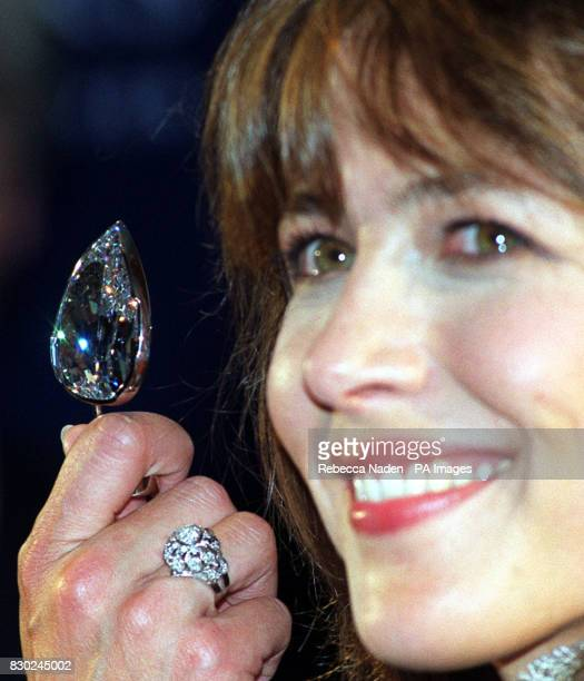 New Bond girl Sophie Marceau holds the De Beers Millennium Star at its unveiling in London The 2034 carat jewel according to diamond merchants De...