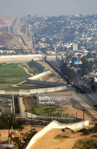New border fences zigzag next to the original straight US/Mexico border fence that divides the US from Tijuana Mexico a few miles east of Border...