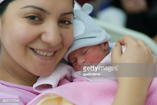 New born baby with his mother