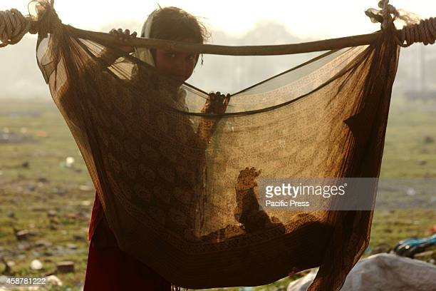 A new born child in his makeshift cotcumswing on Monday evening in Allahabad Around 11000 street dwellers live in Allahabad city under the open skies