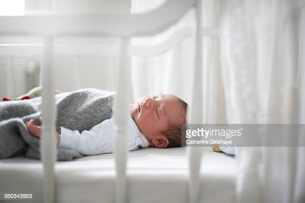 A new born sleeping in his cradle