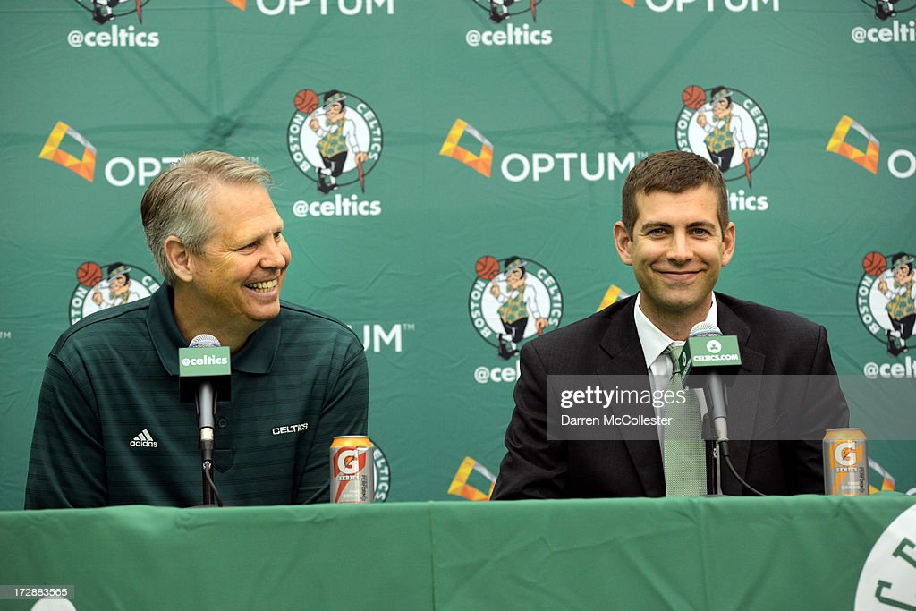 New Boston Celtics head coach Brad Stevens (R) is introduced to the media by President of Basketball Operations Danny Ainge July 5, 2013 in Waltham, Massachusetts. Stevens was hired away from Butler University where he led the Bulldogs to two back to back national championship game appearances in 2010, and 2011.