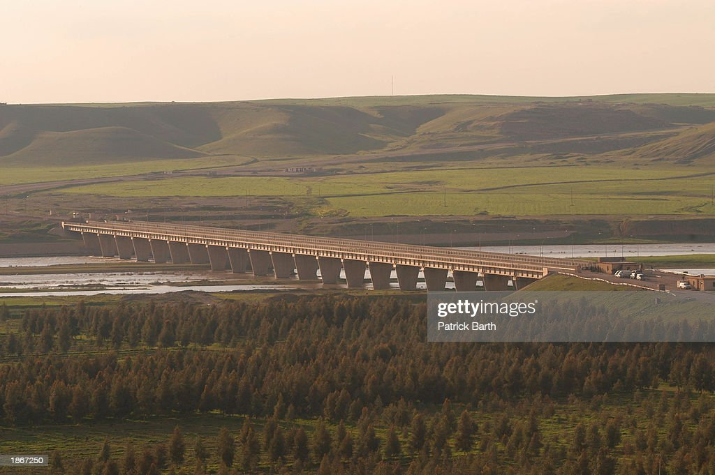 A new bridge spans a broad tributary of the Tigris River March 23 2003 in Kalak in northern Iraq The bridge is said to be mined and will be blown up...