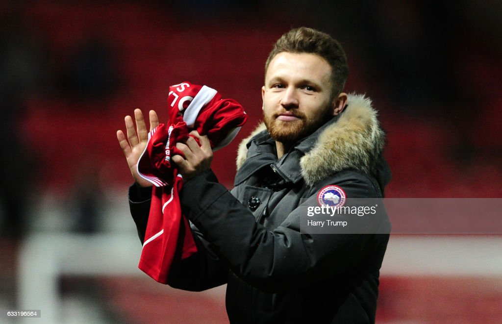 New Bristol City signing Matty Taylor poses with his shirt at half time after being unveiled to his new fans after moving from rivals Bristol Rovers during the Sky Bet Championship match between Bristol City and Sheffield Wednesday at Ashton Gate on January 31, 2017 in Bristol, England.