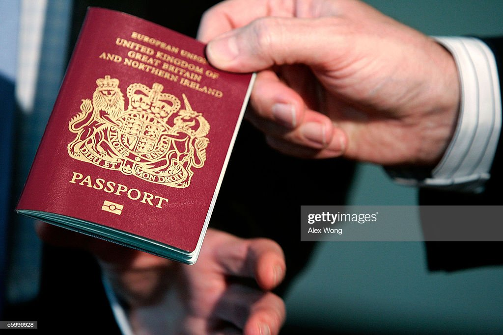 A new British biometric European Union passport which is embedded with a microchip is shown during a news briefing at the British Embassy October 24...
