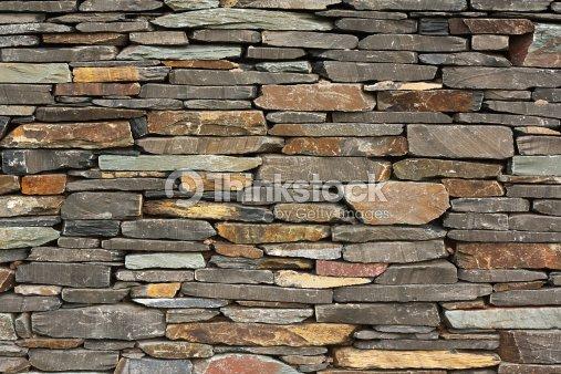 Nouvelle construction chasse un mur de pierres photo thinkstock - Prix construction mur en pierre ...