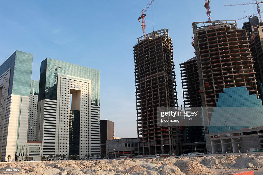 New buildings are seen under construction in Doha, Qatar, on Thursday, Nov. 22, 2012. Qatar Telecom QSC, the country's biggest company by revenue, is seeking a syndicated loan for about $1 billion to refinance existing debt, according to a person with direct knowledge of the deal. Photographer: Gabriela Maj/Bloomberg via Getty Images