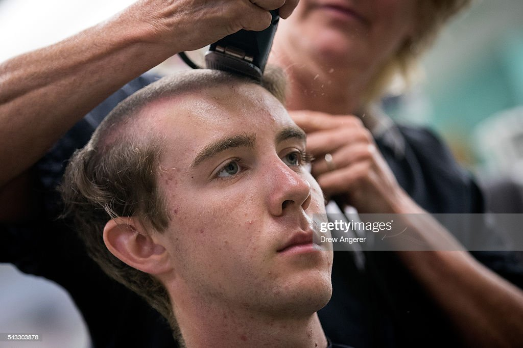 A new cadet receives a military haircut at the barber shop on campus during Reception Day at the United States Military Academy at West Point, June 27, 2016 in West Point, New York. Reception Day is the day when new cadets report to West Point to begin the process of becoming West Point cadets and future U.S. Army officers. Upwards of 1,300 cadet candidates for the class of 2020 will report to West Point on Monday. The new cadets will begin six weeks of basic training before Acceptance Day in early August.