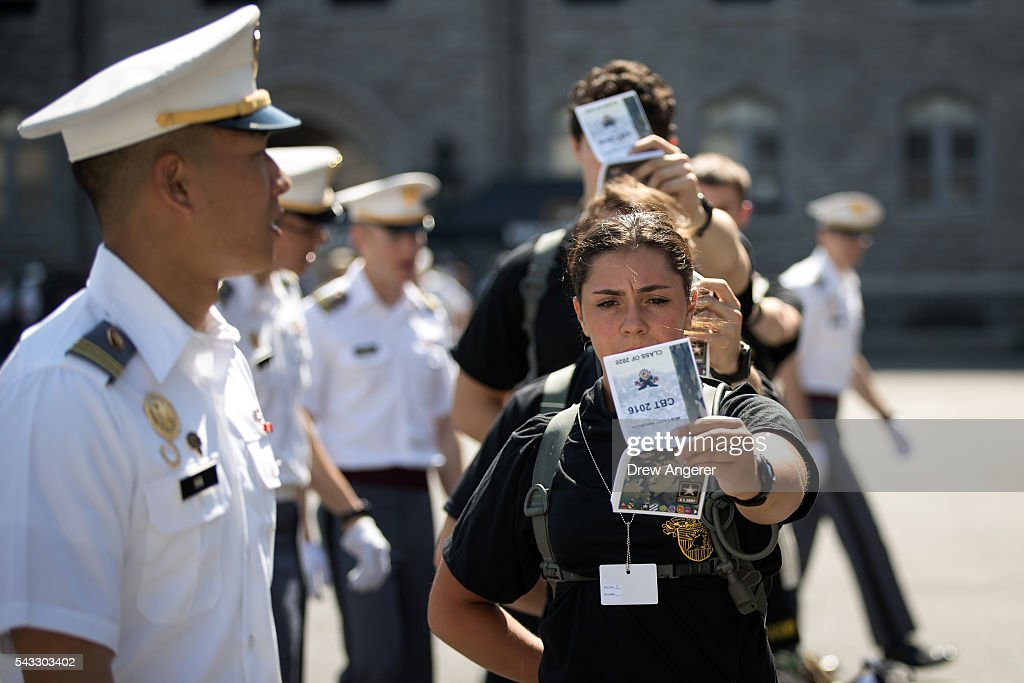 New cadets hold and read booklets called 'Cadet Knowledge' during Reception Day at the United States Military Academy at West Point, June 27, 2016 in West Point, New York. Reception Day is the day when new cadets report to West Point to begin the process of becoming West Point cadets and future U.S. Army officers. Upwards of 1,300 cadet candidates for the class of 2020 will report to West Point on Monday. The new cadets will begin six weeks of basic training before Acceptance Day in early August.
