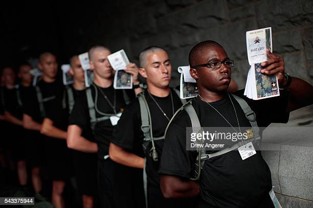 New cadets hold and read booklets called 'Cadet Knowledge' during Reception Day at the United States Military Academy at West Point June 27 2016 in...