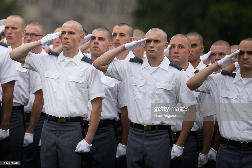 New cadets salute during the Oath of Allegiance ceremony during Reception Day at the United States Military Academy at West Point, June 27, 2016 in West Point, New York. Reception Day is the day when new cadets report to West Point to begin the process of becoming West Point cadets and future U.S. Army officers. Upwards of 1,300 cadet candidates for the class of 2020 will report to West Point on Monday. The new cadets will begin six weeks of basic training before Acceptance Day in early August.