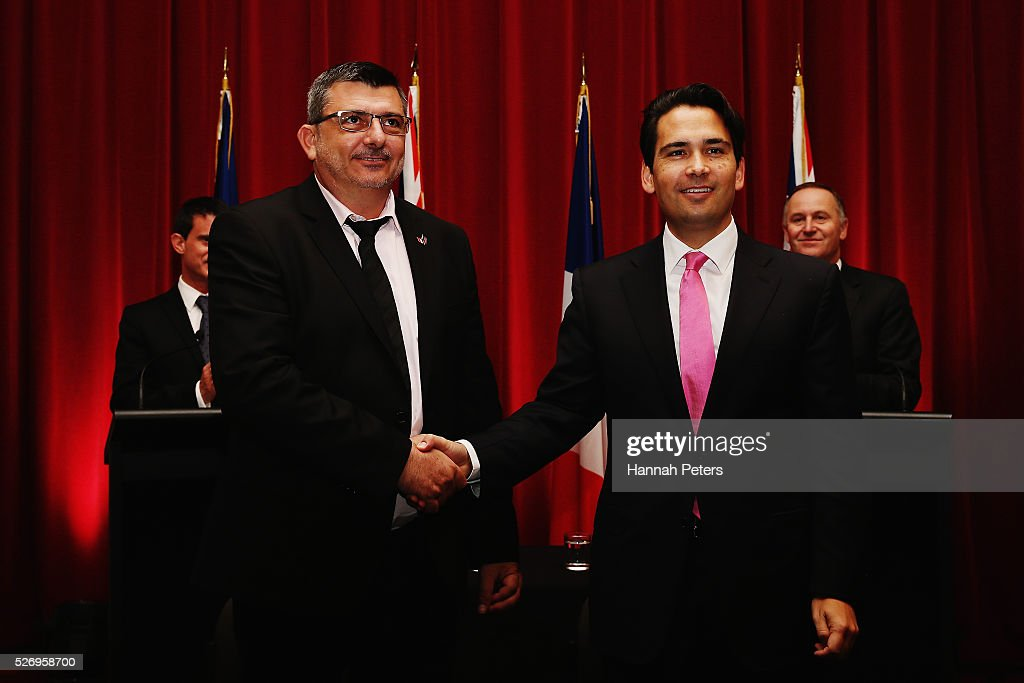New Caledonia President Philippe Germain shakes hands with New Zealand Transport Minister Simon Bridges after signing an agreement for new air services arrangements at the Auckland museum on May 2, 2016 in Auckland, New Zealand. It is the first time in 25 years that a French Prime Minister has visited New Zealand.