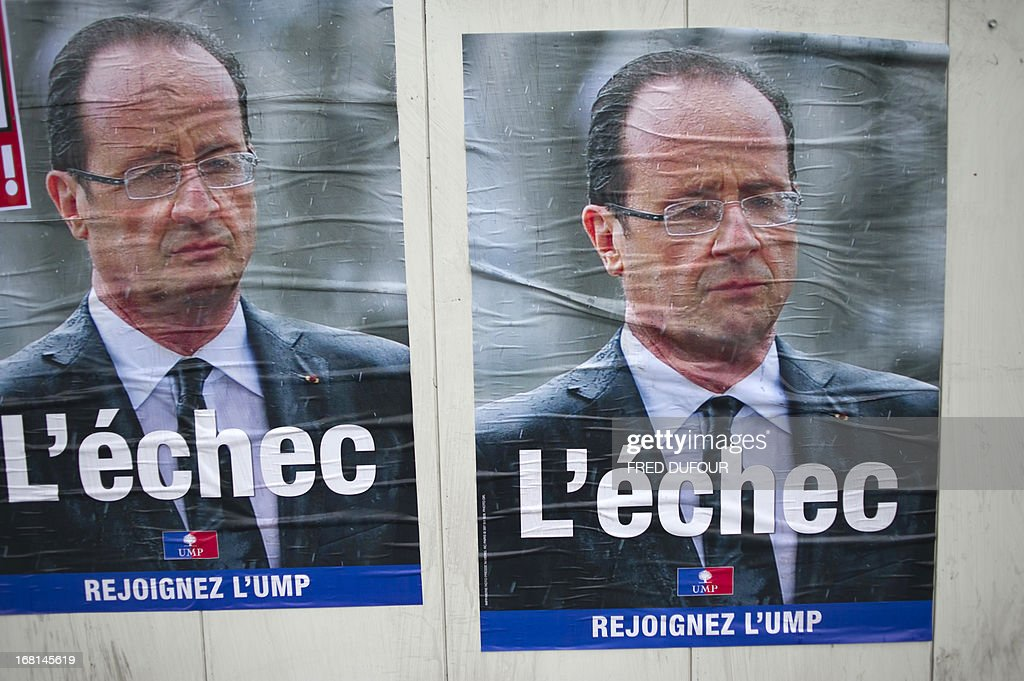 New campaign posters of the French right wing opposition party UMP showing French President Francois Hollande and reading 'L'Echec' ('The failure') are pictured in a street of Paris in May 6, 2013. When he swept to power last May on a wave of discontent, Francois Hollande could hardly have imagined that a year later he would be the most unpopular president in modern French history.
